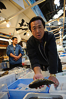 Portraits of people who work at Tsukiji fish market, Tokyo, Japan, October 15, 2009. The Tokyo Metropolitan Central Wholesale Market, better known as Tsukiji market, is the largest fish market in the world. Tsukiji is both a popular tourist attraction and a Mecca of Japanese food culture.