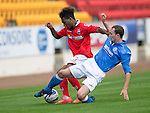 St Johnstone v Ross County....SPFL Development League...19.08.14<br /> Chris Kane tackles Rosario Latouchent<br /> Picture by Graeme Hart.<br /> Copyright Perthshire Picture Agency<br /> Tel: 01738 623350  Mobile: 07990 594431