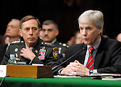 Washington, DC - April 8, 2008 -- General David Petraeus, left, and Ambassador Ryan Crocker, right, testify before the United States Senate Armed Services Committee on the situation and progress in Iraq in Washington, D.C. on Tuesday, April 8, 2008..Credit: Ron Sachs / CNP
