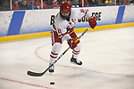 ST CHARLES, MO - MARCH 19:  Sydney McKibbon (11) of the Wisconsin Badgers shoots the puck during the Division I Women's Ice Hockey Championship held at The Family Arena on March 19, 2017 in St Charles, Missouri. Clarkson defeated Wisconsin 3-0 to win the national championship. (Photo by Mark Buckner/NCAA Photos via Getty Images)