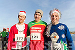 Shane Flynn, Vincent Hilliard and Alan Kelliher, all from Castlegregory, pictured at the Santa Fun Run, in aid of Barretstown, starting from the Tralee Bay Wetlands, on Sunday last.