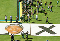 An ANC (African National Congress) rally at the First National Bank (FNB) stadium in Soweto. On the ground is a picture of Nelson Mandela with an X placed next to him to encourage people to vote for him in the upcoming elections.