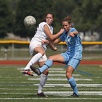 Boston Aztec defender Jessica Morrow (26) and Seacoast United Mariners midfielder Taylor Littlefield (5) battle for the ball. In a Women's Premier Soccer League (WPSL) match, Boston Aztec (white) defeated Seacoast United Mariners (blue), 2-1, at North Reading High School Stadium on Arthur J. Kenney Athletic Field on on June 23, 2013. Due to injuries through the season, Seacoast United Mariners could only field 10 players.