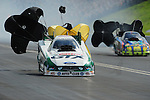 Jun. 19, 2011; Bristol, TN, USA: NHRA funny car driver Mike Neff (left) against Tony Pedregon during eliminations at the Thunder Valley Nationals at Bristol Dragway. Mandatory Credit: Mark J. Rebilas-