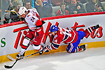 21 December 2008: Carolina Hurricanes' right wing forward Scott Walker keeps ahead of a falling Montreal Canadiens' center Tomas Plekanec from the Czech Republic in the first period at the Bell Centre in Montreal, Quebec, Canada. The Hurricanes defeated the Canadiens 3-2 in overtime. ***** Editorial Sales Only ***** Mandatory Photo Credit: Ed Wolfstein Photo