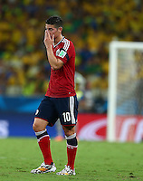 James Rodriguez of Colombia shows a look of dejection