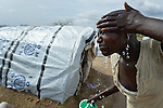 A woman washes here face in a camp for almost 500 internally displaced people located at the St. Vincent de Paul Catholic parish on the edge of Juba, the capital of South Sudan. The families here fled fighting that broke out in December 2013. More than 700,000 people have been internally displaced in the first three months.