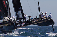 PORTUGAL, Cascais. 5th August 2011. America's Cup World Series. Practice day. ORACLE Racing Spithill, sails over TEAM KOREA.
