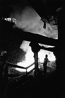 """Poland. Silesia. Bobrek. """" Hutta Bobrek """" is the factory's name. Metallurgist at work. Major polluted area due to old iron and steel works and heavy metals supended in the air. Bobrek is a small town, distant 20 km from Katowice. © 1991 Didier Ruef"""