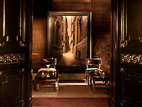 Brown velvet, dark wood and large sepia photographic prints create a dramatic masculine feel to the bar of the Hotel de Rome in Berlin
