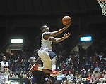 "Ole Miss guard Dundrecous Nelson (5)  dribbles past Alcorn State's Tony Eakles (30) at the C.M. ""Tad"" Smith Coliseum in Oxford, Miss. on Thursday, December 29, 2010. Ole Miss won 100-62. (AP Photo/Oxford Eagle, Bruce Newman)"