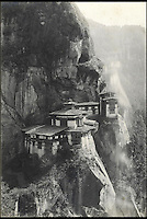 BNPS.co.uk (01202 558833)<br /> Pic: Bonhams/BNPS<br /> <br /> A cliff-side monastery which forms part of the Paro-taktsang monastery, which is perched on the face of a cliff thousands of feet above sealevel. <br /> <br /> Fascinating 112 year-old photographs of Bhutan taken decades before the remote country in the Himalayas became open to outsiders have been unearthed.<br /> <br /> The images provide an unprecedented insight into the isolated kingdom nestled between India and China in the heart of the Himalayas at the beginning of the 20th century. <br /> <br /> The country was almost completely cut off for centuries as it sought to protect its ancient traditions and has only become more accessible to visitors since the 1970s. Such has been their desire to protect their heritage they didn't have TV until 1999.<br /> <br /> The photographs are believed to have belonged to the family of someone who took part in the expedition to Bhutan in 1905 and have since been passed to a private collector.<br /> <br /> The present owner has now decided to submit them for auction and they are tipped to sell for &pound;15,000.