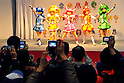 Tokyo, Japan - March 24: Visitors took pictures as models with costumes of Smile Purikyua, a TV animation series, posed at Tokyo International Anime Fair at Tokyo Big Sight, Koto, Tokyo, Japan on March 24, 2012. The fair was the largest animation exhibition in the world, and 216 companies had their booths to show their products.