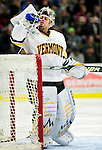 24 November 2009: University of Vermont Catamount goaltender Mike Spillane, a Senior from Bow, NH, takes some hydration during a game against the University of Massachusetts Minutemen at Gutterson Fieldhouse in Burlington, Vermont. The Minutemen defeated the Catamounts 6-2. Mandatory Credit: Ed Wolfstein Photo