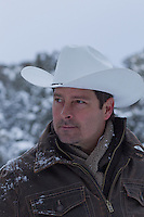 portrait of a good looking middle aged cowboy in the winter