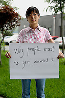 Meng Hai Lin - 29 Yrs.<br /> Mobile phone Engineer.<br /> Beijing.<br /> <br /> 'Why people must to get married'.