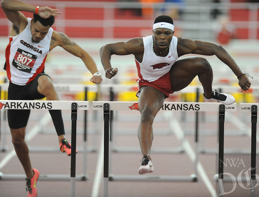 NWA Democrat-Gazette/ANDY SHUPE - Omar McLeod (right) of Arkansas pulls away from Devon Williams of Georgia (left) as he competes in the 60-meter hurdles during the Tyson Invitational Friday, Feb. 13, 2015, at the Randal Tyson Track Center in Fayetteville.