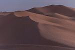 Algodones Dunes, Glamis, California; tire tracks in the sand dunes at twilight
