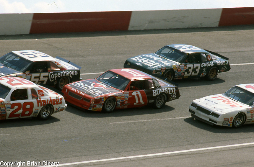 Cale Yarborough (28) Benny Parsons (55) Sterling Marlin (1) Harry Ganr (33) action pack  Motorcraft 500 at Atlanta International Raceway in Hampton, GA on March 16, 1986.   (Photo by Brian Cleary/www.bcpix.com)