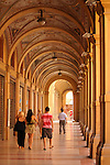 An arcade with painted ceilings in Bologna, Italy.