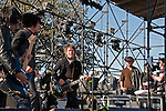 D Generation performing at Fun Fun Fun Fest at Auditorium Shores while actor Ryan Gosling looks on, Austin Texas, November 4, 2011.  D Generation (also known as DGen) are an American glam punk band formed in 1991 in New York City. Ryan Gosling was at the Festival filming the movie Lawless with director Terrence Malick.