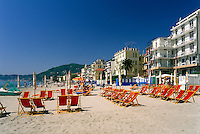 Italy, Liguria, Riviera, Alassio: beach with red deckchairs