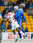 St Johnstone v Hamilton Accies...10.05.11.Michael Duberry clears from Nigel Hasselbaink.Picture by Graeme Hart..Copyright Perthshire Picture Agency.Tel: 01738 623350  Mobile: 07990 594431