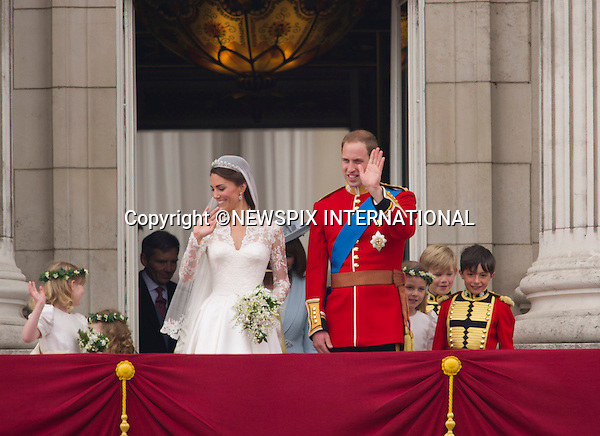 """Prince William and Catherine Middleton Kiss on the Buckingham Palace Balcony and and arrive in Carriages to Buckingham palace.THE ROYAL WEDDING.Prince William and Catherine Middleton delight the crowds with a kiss..The Newly married coupleThe Duke and Duchess of Cambridge take in the splendor of the crowds from the balcony of Buckingham Palace..Prince William and Catherine Middleton marry at Westminster Abbey..The Duke and Duchess of Cambridge London_29/04/2011.Mandatory Photo Credit: ©Dias/Newspix International..**ALL FEES PAYABLE TO: """"NEWSPIX INTERNATIONAL""""**..PHOTO CREDIT MANDATORY!!: NEWSPIX INTERNATIONAL(Failure to credit will incur a surcharge of 100% of reproduction fees)..IMMEDIATE CONFIRMATION OF USAGE REQUIRED:.Newspix International, 31 Chinnery Hill, Bishop's Stortford, ENGLAND CM23 3PS.Tel:+441279 324672  ; Fax: +441279656877.Mobile:  0777568 1153.e-mail: info@newspixinternational.co.uk"""