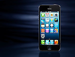 Apple iPhone 5 black smartphone isolated on dynamic blue background with copy space