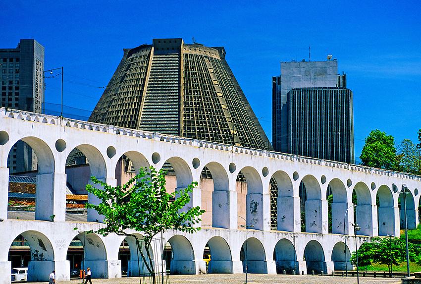 Caruica Aqueduct (a.k.a. Arcos da Lapa) carries the Santa Teresa streetcar, Catedral Metropolitana in background), Rio de Janeiro, Brazil