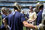 23 April 2016: Notre Dame assistant coach Gerry Byrne talks to his players. The University of North Carolina Tar Heels hosted the University of Notre Dame Fighting Irish at Kenan Stadium in Chapel Hill, North Carolina in a 2016 NCAA Division I Men's Lacrosse match. UNC won the game 17-15.