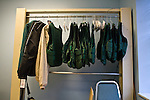 Protective vests hang in the starter's office at Churchill Downs, home of the Kentucky Derby. Start crews are required to wear the vests for protection due to their working in close contact with the animals while loading them in the gates. Thoroughbred race horses are known to be tempermental and powerful and can cause serious injury. Start crews work seasonally and are busy during Triple Crown season which includes the Kentucky Derby.