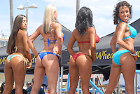 Women pose during the the Muscle Beach Bodybuilding championship at Venice Beach on Monday, September 5, 2011..