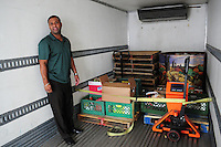 Phoenix, Arizona. October 18, 2012 - Ollie W. Belcher, Jr. -United Food Bank Supervisor of Operations- inspects food inside a delivery truck that just arrived to the warehouse. He said in past years trucks arrived with larger amounts of food, compared to the smaller amount pictured. As the amount of food donations decreases, food banks such as the United Food Bank strive to keep up with hunger relief needs of 1 in 5 (20%) of Arizonans who are living in poverty and, based on figures of the Department of Health and Human Services. Photo by Eduardo Barraza © 2012