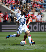 LA Galaxy midfielder Juninho (19) plays the ball in front of Chicago midfielder Chris Rolfe (18).  The LA Galaxy defeated the Chicago Fire 2-0 at Toyota Park in Bridgeview, IL on July 8, 2012.