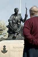 25 April 2004 - Crepon, France - Former military Charles Kirkpatrick, now working as a civilian historian under contract with the US Army in Germany, observes a statue commemorating D-Day in the small Normandy village of Crepon, 25 April 2004. He is visiting the region to take part in the preparation of the celebration of the 60th anniversary of D-Day. His role will include explaining the event of June 1944 to participating American soldiers, some of which will have just returned from Iraq.