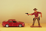 Cowboy threatens car