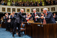 TALLAHASSEE, FLA. 11/18/14-ORGSESS111814CH-Gov. Rick Scott, center, shakes outgoing Sen. John Thrasher, R-St. Augustine, as Scott is recognized by the Senate during Organizational Session, Nov. 18, 2014 at the Capitol in Tallahassee.<br /> <br /> COLIN HACKLEY PHOTO