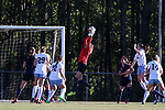 CARY, NC - APRIL 08: Courage's Katelyn Rowland (in red) grabs the ball. The NWSL's North Carolina Courage played a preseason game against the University of North Carolina Tar Heels on April 8, 2017, at WakeMed Soccer Park Field 3 in Cary, NC. The Courage won the match 1-0.