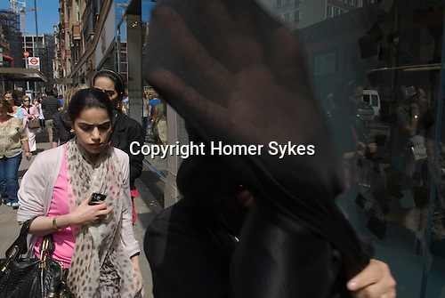 Middle Eastern tourists in Knightsbridge London 2009. Arab make prevents a picture being taken.