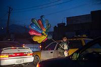 Balloon seller at night in Kabul 5-1-14