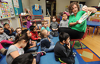 NWA Democrat-Gazette/ANDY SHUPE<br /> Laura King Kellams, executive director of Arkansas Advocates for Children and Families of Northwest Arkansas, reads to students Thursday, Feb. 2, 2017, at the Springdale Pre-Kindergarten Center in Springdale.