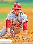 7 March 2012: St. Louis Cardinal outfielder Erik Komatsu dives safely back to first during action against the Washington Nationals at Space Coast Stadium in Viera, Florida. The teams battled to a 3-3 tie in Grapefruit League Spring Training action. Mandatory Credit: Ed Wolfstein Photo