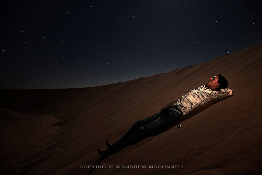 Brahim Mohamed Fadin, 17, pictured in sand dunes near Smara refugee camp, Algeria...I don't like to be in the refugee camps. I know that the Algerians receive us and help us for many years but I want to be free in my own country. I am in High School in Algeria and Saharawis always get the best grades there. We are learning for our people, we learn to spread our history and in Algeria we can do that. I'm studying maths and my goal is to be a engineer. I wish I could help my country, its needs a lot of specialists. I would rather live in the camps than live under moroccan control. ..Everyone seeks for peace and the white flag. I like war only if it brings peace and I am prepared to give my life if it would give us real peace. I don't like war in the Sahara because everyone knows the Sahara is a peaceful place and I want Saharawis and Morroccans to live peacefully as states like Algeria and Mauritania, as friends. It is my point of view that it was better to keep fighting to free our land than to stop and let others take our resources. If we gain our independence we will be one the best states in the world because we are known for our solidarity and friendship and hospitality. Life taught us a lot because of everything, all the suffering, there are no people like us anywhere in the world..