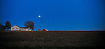A barn and a full moon.  Kansas City, Missouri.