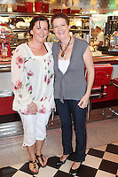 "NO REPRO FEE. 26/5/2011. NEW EDDIE ROCKET'S SHAKE SHOP. Valerie Scully and Mags Tierney are pictured in the new Eddie Rocket's Shake Shop. The design seeks to recall the vintage milkshake bars from 1950's America and re-imagine them for the 21st century. The new look aims to appeal to both young and old with a quirky and bold colour scheme and a concept of make-your-own milkshakes, based on the tag line ""You make it...We shake it!"". Eddie Rocket's City Diner in the Stillorgan Shopping Centre in south Dublin has re-opened after an exciting re-vamp and the addition of a Shake Shop. Ten new jobs have been created with the Diner's re-launch bringing the total working in Eddie Rocket's Stillorgan to 30. Picture James Horan/Collins Photos"