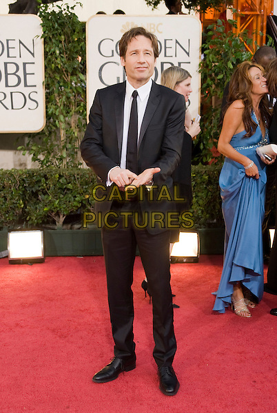 DAVID DUCHOVNY.Arrivals at the 66th Annual Golden Globe Awards held at the Beverly Hilton Hotel, Beverly Hills, California, USA..January 11th, 2009.*Editorial Use Only* .globes full length black suit hands.CAP/AWF/HFPA .Supplied by Capital Pictures.