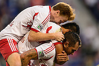 Dax McCarty (11), Tim Cahill (17) and Jonny Steele (22)  of the New York Red Bulls (top to bottom) celebrate an FC DAllas own goal. The New York Red Bulls defeated FC Dallas 1-0 during a Major League Soccer (MLS) match at Red Bull Arena in Harrison, NJ, on September 22, 2013.