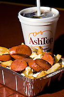 A sausages poutine from Chez Ashton, a popular fast food chain in the Quebec City area.  Poutine is a French Canadian dish consisting of French fries topped with fresh cheese curds and covered with hot gravy.