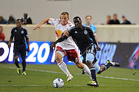 Jan Gunnar Solli (8) of the New York Red Bulls and C.J. Sapong (17) of Sporting Kansas City battle for the ball. The New York Red Bulls defeated Sporting Kansas City 1-0 during a Major League Soccer (MLS) match at Red Bull Arena in Harrison, NJ, on April 30, 2011.